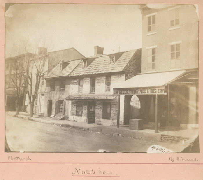 """The residence (the two-storey house in the middle) of tanner Leonard Nutz built circa 1730 at 5329 West Penn Street, Germantown; (A photo of Frederick De Bourg Richards, April 1859; Courtesy of Library Company of Philadelphia Print Dept)<br /> Notes: """"A very old stone house, of two storys, owned and dwelt in by Nutz, a tanner, who had his tanyard along the street, southward. It is now a house resting some two feet or more below the street pavement but in former years (before the turnpike was laid there at a higher grade)... It had two steps upwards of entrance form the street. It was originally the Van de Waestyne House... On the Main Street of Germantown - on the north side of the street, between Shoemaker and Mill street""""."""