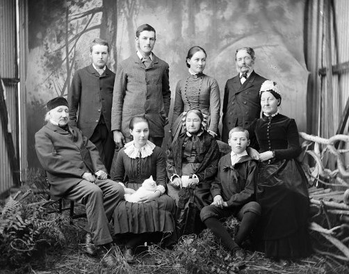 Dr John Danforth Greenwood (far left) and his wife Sarah Fields-Greenwood (far right), with family members in between (a photo from early 1850s). The girl with the cat in the first row is probably the young Jane Greenwood.